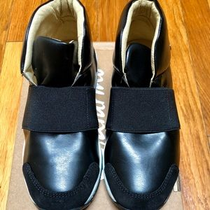 BNIB black slip on shoes. Hits ankle.